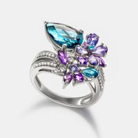 Золотое кольцо с бриллиантами, топазами, иолитами и аметистами ЮЕР25754