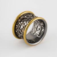 Серебряное кольцо с фианитами и золотом 750'